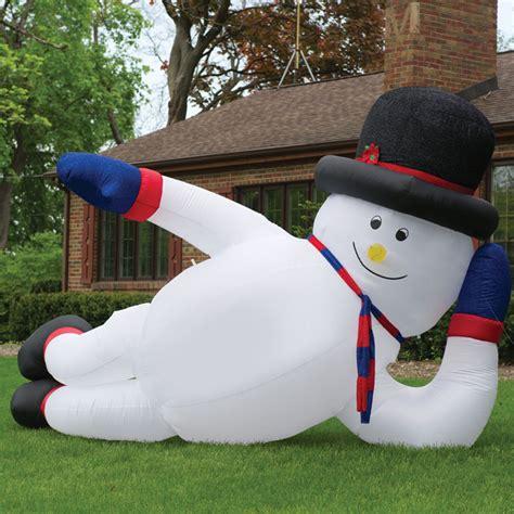 massive inflatable sprawling snowman  green head