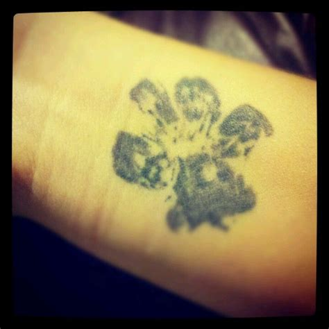 dogs actual paw print tattoo dipped  paw  black