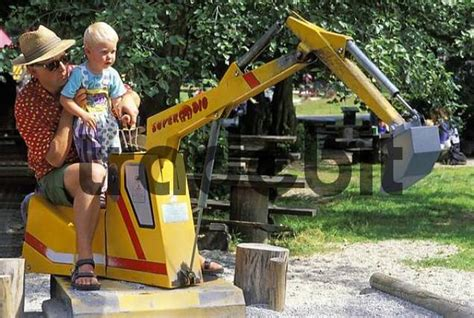 year  boy  toy digger   people