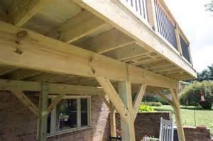 free standing deck against limestone exterior advice decks fencing contractor talk