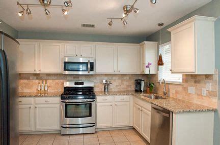 tasteful travertine kitchen austin interior design