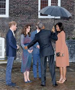 Prince George meets Barack Obama in his dressing gown and ...