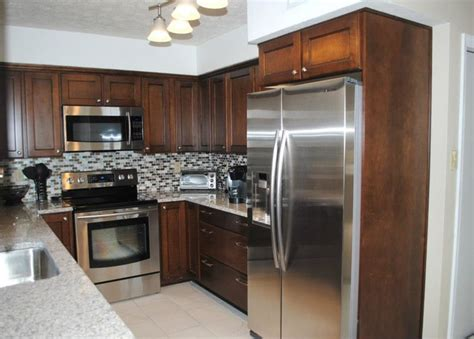 maple briarwood cabinets with black glaze pearl