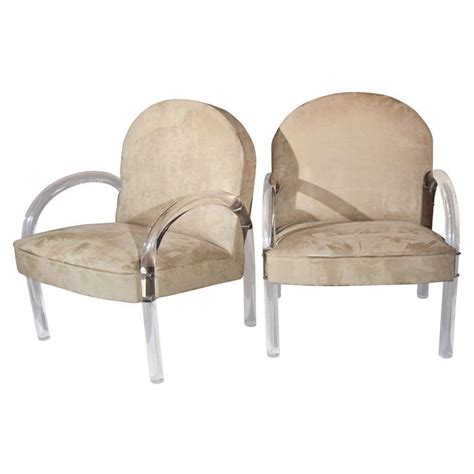 pair of suede chairs w lucite legs arms at 1stdibs