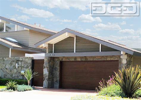 orange county modern style garage door pivot courtyard