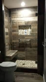 wood plank tiled shower shower seat idea pebble floors