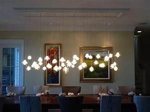 Kadur chandelier over dining room table custom blown