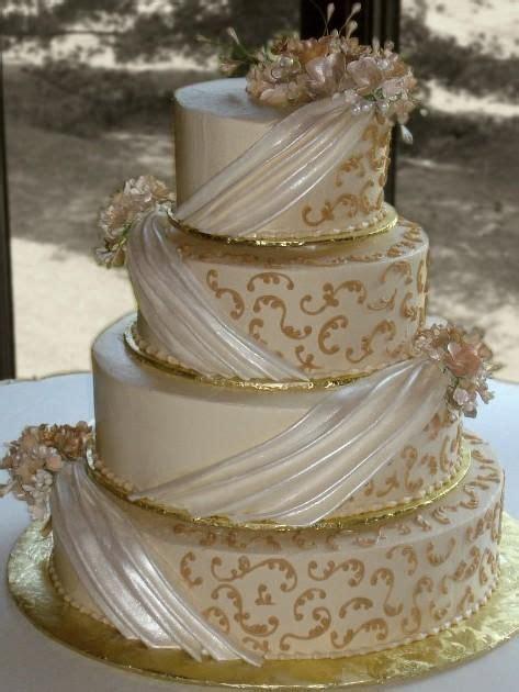 wedding cake drapes candlelight buttercream iced 4 tier wedding cake