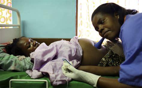 malawi health maternal pregnant child belly nurse support birth labor hospital mortality money ward eyes poor poverty uganda lilongwe faso