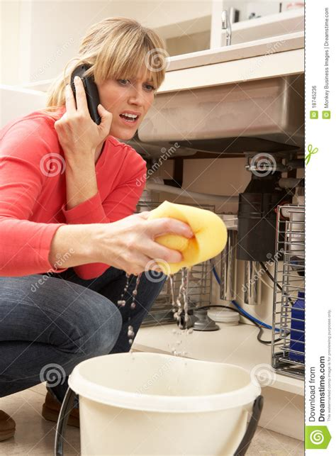 kitchen sink leaks mopping up leaking sink royalty free stock image 2764