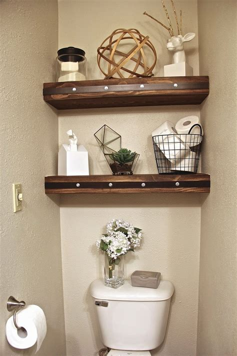 floating shelves   master toilet closet master