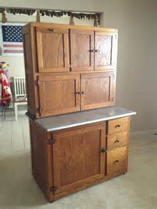 vintage antique oak hoosier kitchen cabinet with flour sugar containers the doors