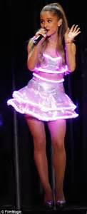 Ariana Grande lights up CMAs stage in LED dress with ...