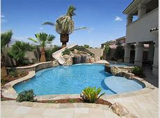 Neutral Tropical Pool with Hidden Grotto & Water Slide HGTV