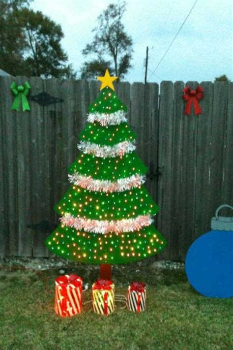 plywood christmas decorations wooden tree we made out of plywood and 250 lights and some garland tree