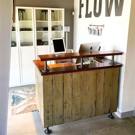 flow cycle studio reception desk lazy guy diy
