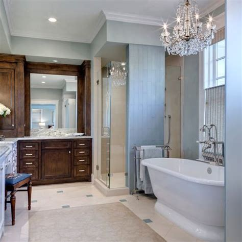 chandelier over freestanding bathtub home bathrooms