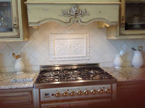 kitchen backsplash colors pressed floral tiles installed in kitchen backsplash