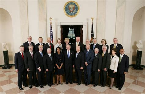president george w bush stands with members of his cabinet in cross at the white house