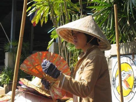 thai fan hat vendor photo