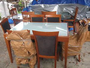 nexus white glass extending dining table and 8 chairs on