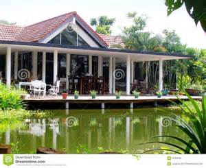 simple one story house plans tropical house veranda pond stock photo image