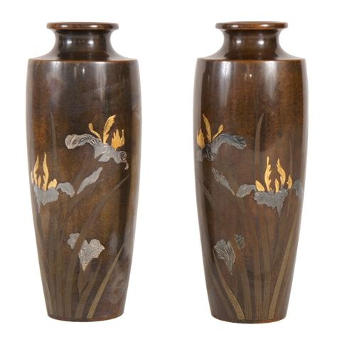 Gold And Silver Vase by A Pair Of Japanese Bronze Vases Inlayed With