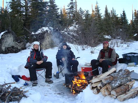 Dog Sledding Winter Camping With White Wilderness