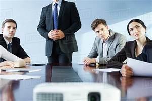 Executive making presentation at business meeting Stock