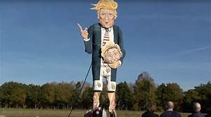 Effigy of Trump holding Hillary Clinton's severed head to ...