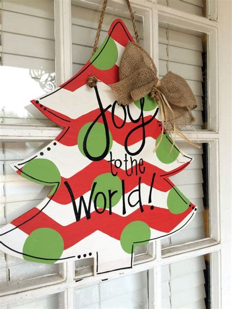how to make a christmas door hanging on youtube tree quot to the world quot wooden door hanger by arhjohnston on etsy etsy