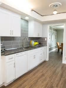 White Galley Kitchen with Black Appliances