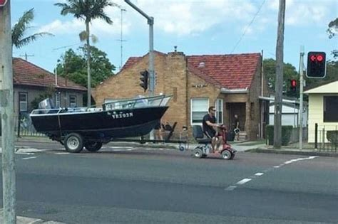 Tow Boat Mobility Scooter by Uses Motorized Wheelchair To Pull Boat