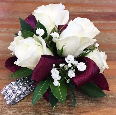maroon  white corsage  homecoming boutonnieres