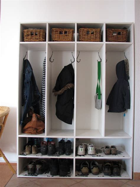 white mudroom with shoe rack storage and hanging