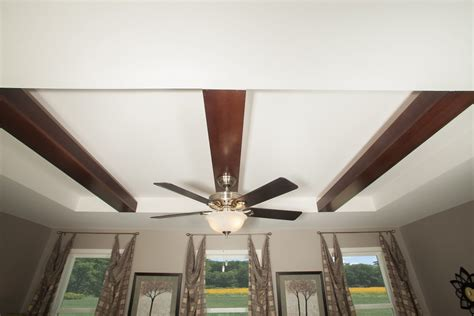 recessed ceiling with dropped beans and ceiling fan