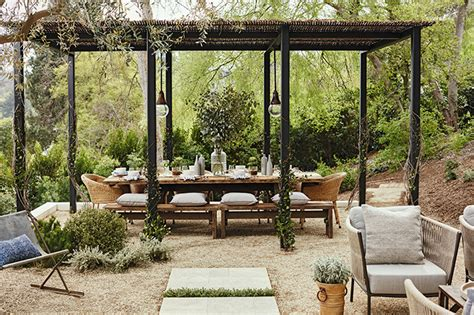 An Outdoor Space Designed For Dining And Relaxing By The Fire