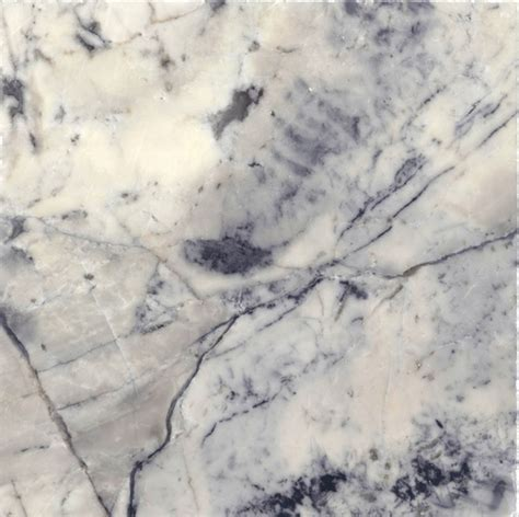 white granite with black and grey veins similar in