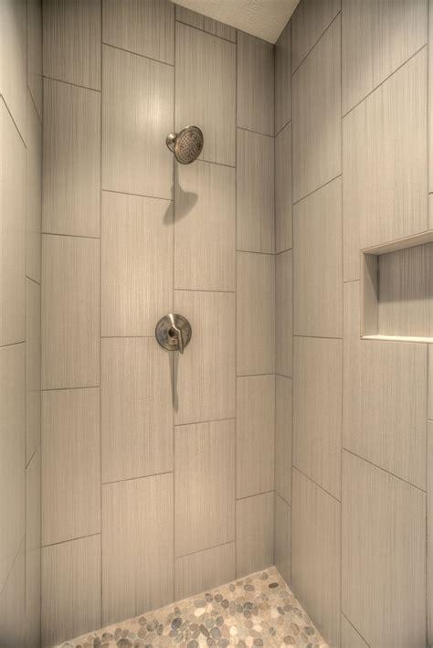 master shower  vertical tile shower shelf pebble