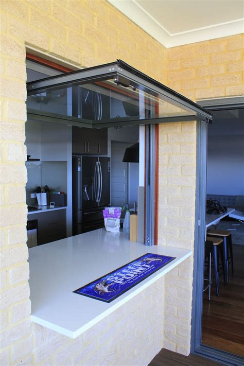 vertical glass lift  doors  windows  brisbane  sunshine coast east coast garage doors