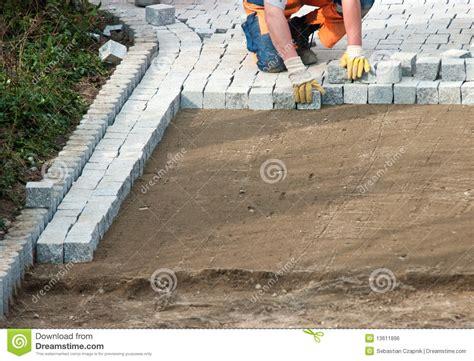 laying paving bricks on soil stock photo image 13611896