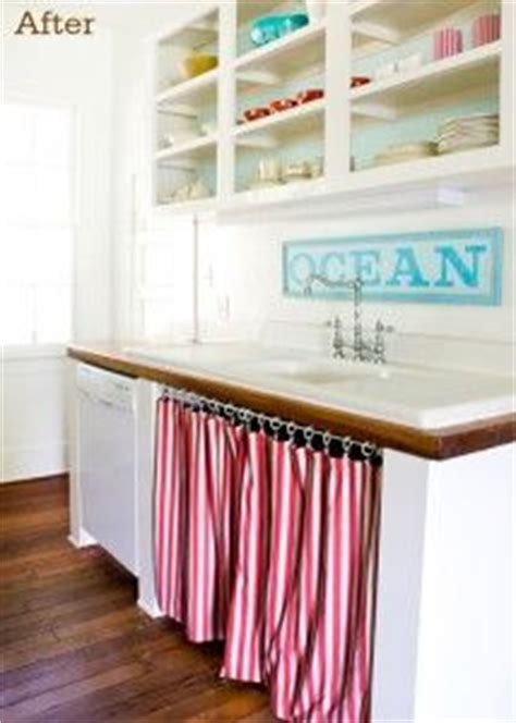 Fabric Curtains For Cabinets by How To Cleverly Conceal Clutter Diy Fabric Curtains