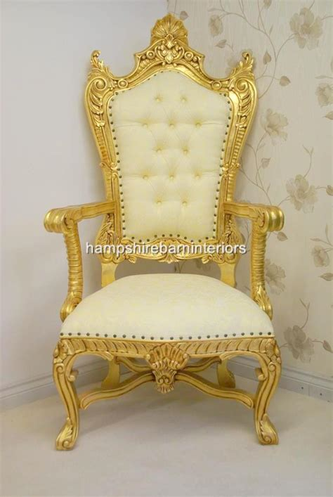 large throne chair in gold and hshire
