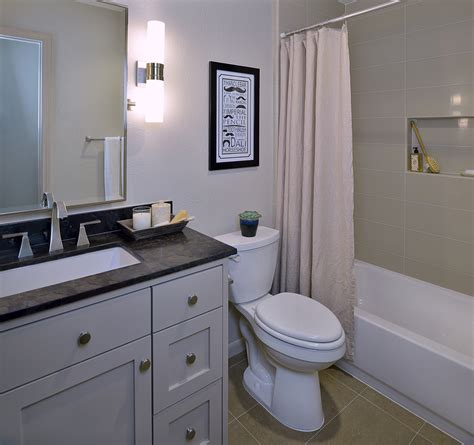 before after a bachelor 39 s dated bathroom gets a contemporary refresh designed