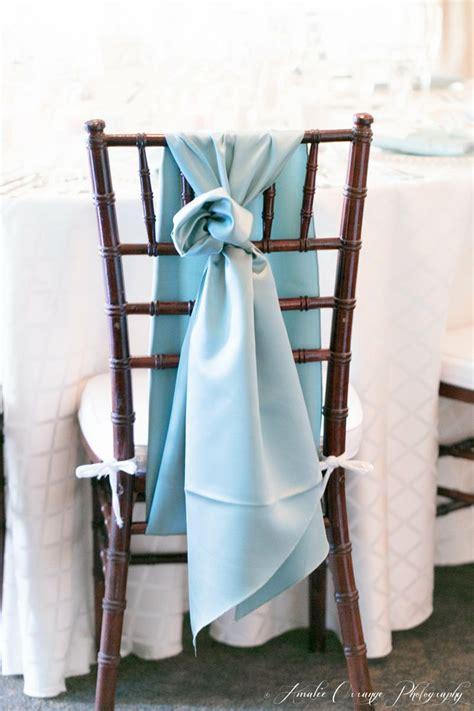 this baby blue chair sash on our mahogany chiavari