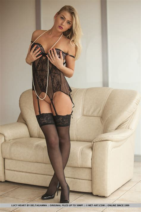 Lucy Heart confidently poses in her sheer black teddy with matching panty, thigh high stockings ...