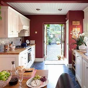 Rich red cabinetry makes this an inviting place to cook for Red country kitchens