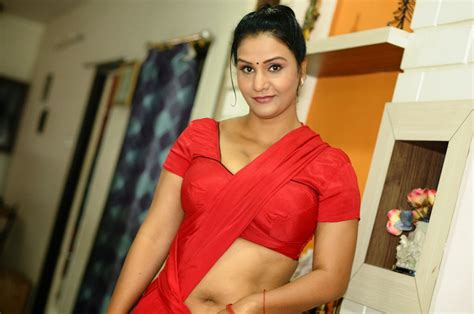 Apoorva Hot Cleavage And Navel Show Stills In Red Saree