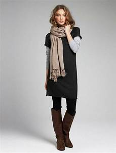 Short sleeved sweater dress over a long sleeved gray cotton tee paired with black leggings and ...