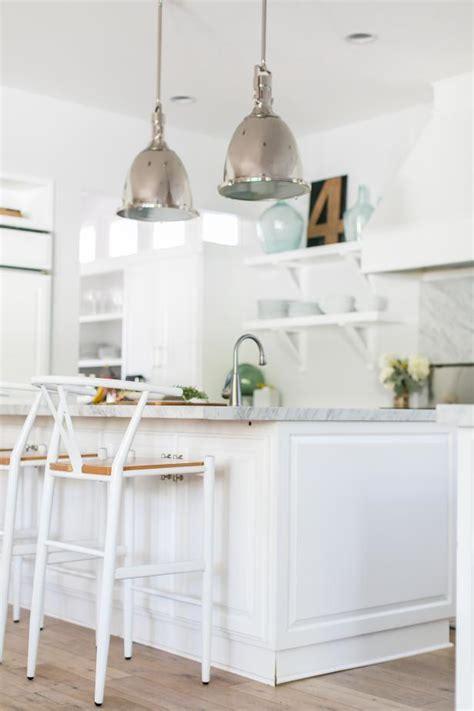 pair  large silver pendant lights  white kitchen